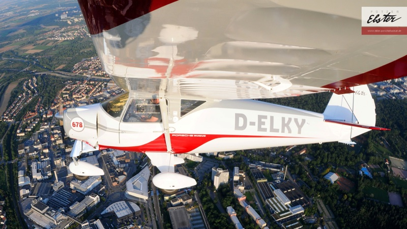 DELKY overflying Porsche Museum.  Flying Ambassador of the Porsche Museum.